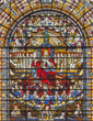 LONDON, GREAT BRITAIN - SEPTEMBER 14, 2017: The Jesus Christ the King on the stained glass in the church St. Edmund the King from 19. cent.