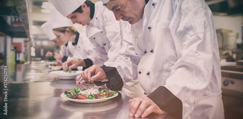Chefs preparing their salads