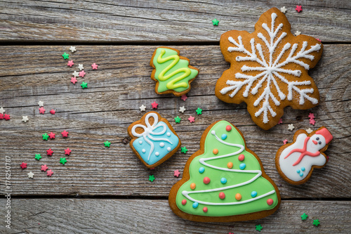 Christmas cookies on rustic wood background Poster