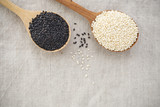 Black and white sesame on wood spoon background with space - 176265160
