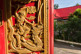 Buddhist carvings on the windows of the church in Rongngae temple at Nan Province, Thailand.