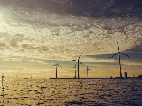 Wind turbines power generator farm along coast sea Poster