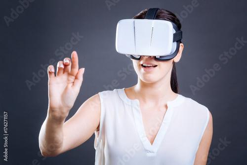 Happy nice woman using virtual panel