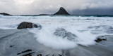 The wild sea flows on a beach of Andenes in Norway - 176280977