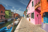 Colourful buildings lining cannal, Island of Burano, Venice Italy
