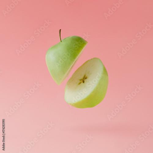 Apple sliced on pastel pink background. Minimal fruit concept. - 176283190