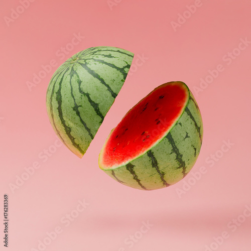 Watermelon sliced on pastel pink background. Minimal fruit concept. - 176283369