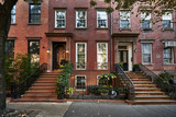 a row of brownstone buildings - 176284915