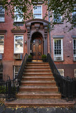 an ornate door on a brownstone building - 176284998