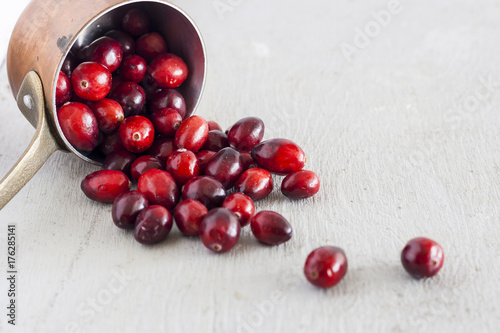 Poster Cranberries Spilling from Copper Cup