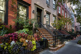 a row of colorful brownstone buildings - 176285390