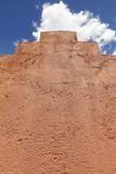 An old clay wall against blue sky. - 176285993