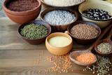 Cereals and legumes in bowls on wooden background  - 176286304