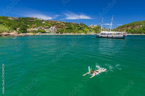 Woman swimming in Buzios, Rio de Janeiro Poster