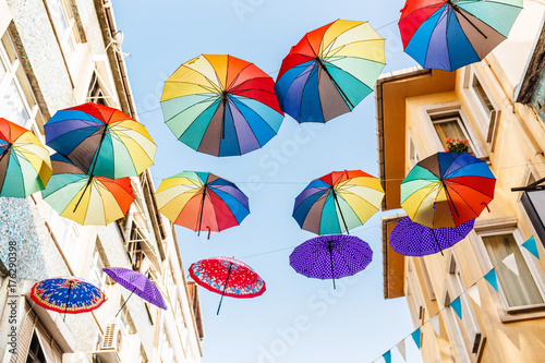 Colorful umbrellas in the sky as street decoration in Istanbul Poster