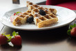 Waffles with Strawberries and Blackberries on wooden table - 176290559