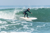 Surfing the waves - 176290786