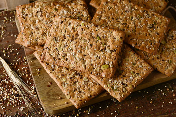 brown crackers topped with seeds