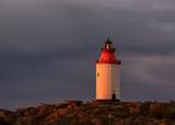 Lighthouse at sunrise. - 176294999