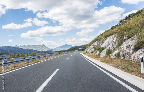 Papiers peints Blanc High-speed country road among the mountains.