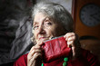Quadro Cunning and looking grandmother with purse