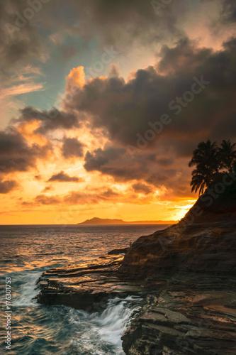 Foto op Canvas Zee zonsondergang Spitting Cave