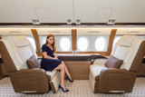 young beautiful woman in Luxury interior in the business jet