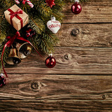 Christmas decorations on rustic wood background