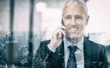 Businessman talking on mobile phone - 176308395