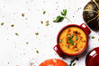 Spicy pumpkin soup in a serving pan, top view - 176319104