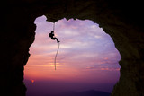 Silhouette of a climber over beautiful sunset - 176321713