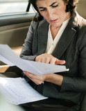 Businesswoman Busy Working Car Inside - 176333775