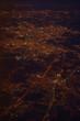 Night city from airplane illuminator