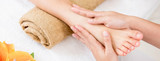 Therapist giving relaxing reflexology Thai foot massage treatment to a woman in spa - 176342961