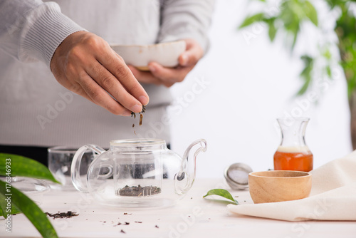 Papiers peints The Pouring healthy tea. Hot tea on a glass teapot on a wooden table.