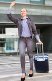 Adult woman worker going with baggage - 176348123