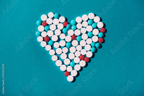 colorful pills in heart symbol Poster