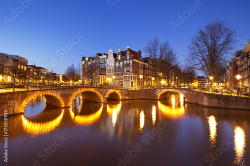 Bridges over canals in Amsterdam at night Poster
