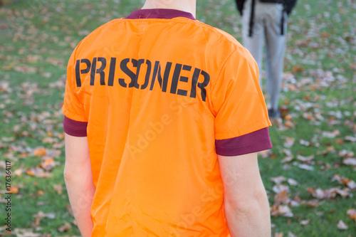 orange clothes for man prisoner in outdoors jail Poster