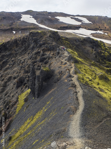 Plagát The path along the black crest of a volcano, overgrown with bright green moss, I