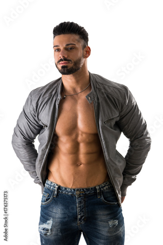 Muscular bodybuilder undressing, opening leather jacket on naked muscle torso, isolated on white background