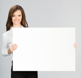 Businesswoman showing signboard, over grey - 176376910