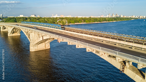 Foto op Canvas Kiev Aerial top view of Metro railway bridge with train and Dnieper river from above, skyline of city of Kiev, Ukraine