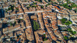 Aerial top view of residential area houses roofs and streets from above, old medieval town background