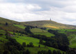 stoodley pike monument in west yorkshire landscape with upland farms and moors in the distance