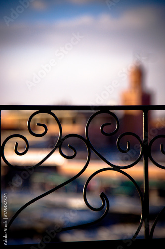 Papiers peints Maroc Wrought iron grating with background the Marrakech Square