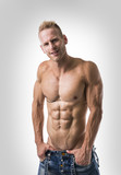 Good Looking Young Gym Fit Man Showing His Sexy Six Pack Abs While Looking at the Camera. on White Background. - 176388566
