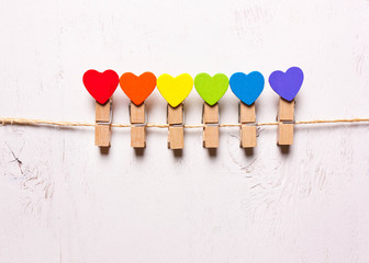 Wooden hearts of rainbow colors on clothespins . The symbol of LGBT © alexmia