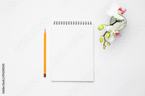 Poster Open notebook with pencil and Flowers orchid