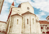 The Cathedral of St. Lawrence is a roman catholic triple-naved basilica constructed in romanesque-gothic, yellow filter - 176392566
